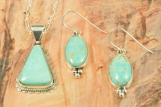 """Genuine Number 8 Mine Turquoise Stones set in Sterling Silver. Beautiful Pendant and Earrings Set with an 18"""" Sterling Silver Chain. Created by Navajo Artists Barbara Hemstreet and Lucy Valencia. Signed by the artists. The Number 8 mine is located in Eureka County Nevada. Since 1976 there has been no Number 8 Turquoise mined. There is however, an existing stock pile that Mr. Dowell Ward, the last owner of the Number 8 mine, had stocked away for later sorting. The Turquoise is a collector's item--because once the reserve is gone there will be no more material released onto the market. The Gold Mining Company owns the claim to the Number 8 mine and it has been swallowed up by the gold mining operations. This is some of the last Number 8 Turquoise to be had and will be a great addition to your collection."""