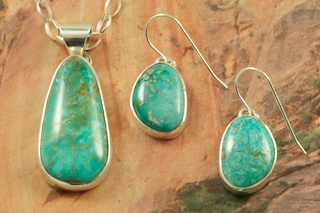 Genuine Emerald Valley Turquoise set in Sterling Silver. Stunning Pendant and Earrings Set. Created by Navajo Artist Tony Garcia. Signed by the artist. The photo is of the jewelry you will be receiving. The Emerald Valley Mine is Located in Nevada.