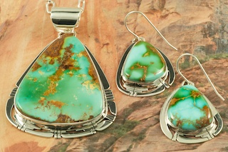 Stunning Pendant and Earrings Set featuring Genuine Royston Turquoise set in Sterling Silver.  The Royston Turquoise Mine was originally known as the Royal Blue Mine. It produces Turquoise that has a mixture of blues and greens in the same formation. The Royston Turquoise Mine is located in Nye County, Nevada. Created by Navajo Artist Phillip Sanchez. Signed by the artist.