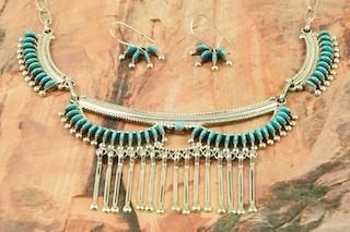 Stunning Necklace and French Wire Earrings featuring Genuine Sleeping Beauty Turquoise set in Sterling Silver. Beautiful Petit Point Design. Many days of painstaking work went into creating this Southwestern Art Masterpiece. Created by Master Zuni Artists Octavious and Irma Seowtewa. Signed by the artists. The Zuni Pueblo is located in New Mexico, Land of Enchantment.