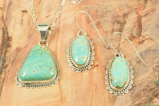 "Genuine Number 8 Mine Turquoise Stones set in Sterling Silver. Beautiful Pendant and Earrings Set with an 18"" Sterling Silver Chain. Created by Navajo Artist Barbara Hemstreet. Signed by the artist. The Number 8 mine is located in Eureka County Nevada. Since 1976 there has been no Number 8 Turquoise mined. There is however, an existing stock pile that Mr. Dowell Ward, the last owner of the Number 8 mine, had stocked away for later sorting. The Turquoise is a collector's item--because once the reserve is gone there will be no more material released onto the market. The Gold Mining Company owns the claim to the Number 8 mine and it has been swallowed up by the gold mining operations. This is some of the last Number 8 Turquoise to be had and will be a great addition to your collection."