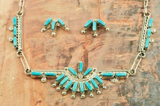 Stunning Necklace and Post Earrings featuring Genuine Sleeping Beauty Turquoise set in Sterling Silver. Beautiful Needle Point Design. Created by Zuni Artist Verina Seoutewa. Signed by the artist. The Zuni Pueblo is located in New Mexico, Land of Enchantment.