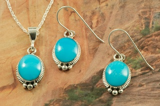 "Genuine Sleeping Beauty Turquoise set in Sterling Silver. Beautiful Pendant and Earrings Set with an 18"" Sterling Silver Chain. Created by Navajo Artist Burt Francisco. Signed by the artist. The Sleeping Beauty Turquoise mine is located in Gila County, Arizona."