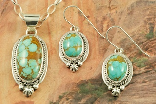 "Genuine Number 8 Mine Turquoise Stones set in Sterling Silver. Beautiful Pendant and Earrings Set with an 18"" Sterling Silver Chain. Created by Navajo Artist Lucy Valencia. Signed L. J. by the artist. The Number 8 mine is located in Eureka County Nevada. Since 1976 there has been no Number 8 Turquoise mined. There is however, an existing stock pile that Mr. Dowell Ward, the last owner of the Number 8 mine, had stocked away for later sorting. The Turquoise is a collector's item--because once the reserve is gone there will be no more material released onto the market. The Gold Mining Company owns the claim to the Number 8 mine and it has been swallowed up by the gold mining operations. This is some of the last Number 8 Turquoise to be had and will be a great addition to your collection."
