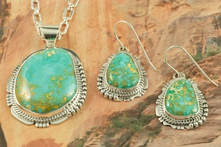 """Genuine Sunnyside Turquoise Stones set in Sterling Silver. Beautiful Pendant and Earrings Set with an 18"""" Sterling Silver Chain. Created by Navajo Artist Sampson Jake. Signed by the artist. The matrix on this rare stone is outstanding. The Sunnyside mine is located in northern Nevada near the town of Tuscarora in the Tuscarora mountain range.The mine is no longer in operation as it has become part of a gold mining operation and a privately owned ranch. The Sunnyside mine was mined mostly in the 70's. You won't find much of this great turquoise around anymore except for old stashes."""