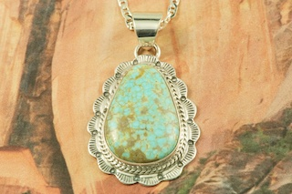 "Genuine Number 8 Mine Turquoise Stone set in Sterling Silver Pendant. Free 18"" Sterling Silver Chain with Purchase of Pendant. Created by Navajo Artist Wilson Padilla. Signed by the artist. The Number 8 mine is located in Eureka County Nevada. Since 1976 there has been no Number 8 Turquoise mined. There is however, an existing stock pile that Mr. Dowell Ward, the last owner of the Number 8 mine, had stocked away for later sorting. The Turquoise is a collector's item--because once the reserve is gone there will be no more material released onto the market. The Gold Mining Company owns the claim to the Number 8 mine and it has been swallowed up by the gold mining operations. This is some of the last Number 8 Turquoise to be had and will be a great addition to your collection."