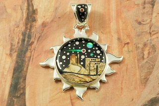 "This Pendant is a work of art! Beautiful Starry Night in the Pueblo Design with a view of Monument Valley. Featuring Picture Jasper and Black Jade inlaid in Sterling Silver Pendant. Beautiful Fire and Ice Lab Opal Moon and Shooting Star! Free 18"" Sterling Silver Chain with Purchase of Pendant. Designed by Navajo Artist Calvin Begay. Signed by the artist."