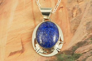 "Beautiful Pendant featuring Genuine Blue Lapis set in Sterling Silver. Free 18"" Sterling Silver Chain with Purchase of Pendant. Created by Navajo Artist Phillip Sanchez. Signed by the artist."
