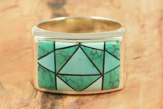 Stunning Ring featuring Genuine High Grade Turquoise inlaid in Sterling Silver.  Designed by Navajo Artist Calvin Begay. Signed by the artist.