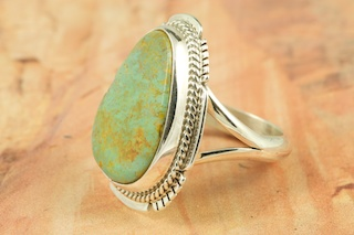 Genuine Royston Turquoise Stone set in Sterling Silver Ring. The Royston Turquoise Mine is located in Nye County, Nevada. Created by Navajo Artist Kathy Yazzie. Signed by the artist.
