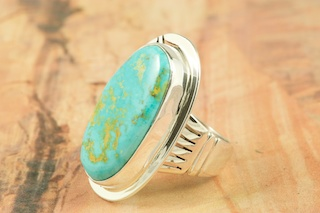 Genuine Royston Turquoise Stone set in Sterling Silver Ring. The Royston Turquoise Mine is located in Nye County, Nevada. Created by Navajo Artist Phillip Sanchez. Signed by the artist.