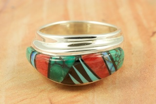 Stunning Ring featuring Genuine High Grade Turquoise, Spiny Oyster Shell and Black Jade inlaid in Sterling Silver.  Designed by Navajo Artist Calvin Begay. Signed by the artist.