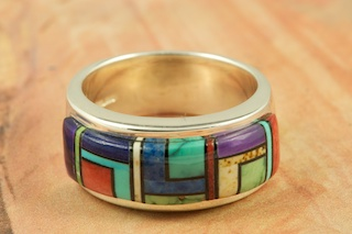 Beautiful Mosaic of Genuine Turquoise, Spiny Oyster Shell, Black Jade and Blue Lapis inlaid in Sterling Silver. Stunning Ring Designed by Navajo Artist Calvin Begay. Signed by the artist.