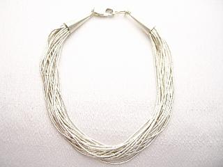 20 Strand Liquid Silver Bracelet .925 Sterling Silver. Soft and silky to the touch.