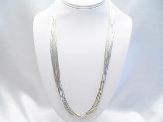 24 inches long Liquid Silver Necklace with Sterling Silver Cones and Clasp. Liquid Silver is 925 Sterling Silver. Beautiful worn alone or add your favorite pendant.